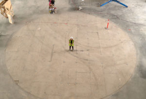 Jessica Kent stands where Alex Janvier's tile mosaic will be installed.